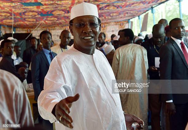 Chad's incumbent president Idriss Deby Itno arrives to cast his ballot at a polling station in N'djamena for the presidential election on April 10...