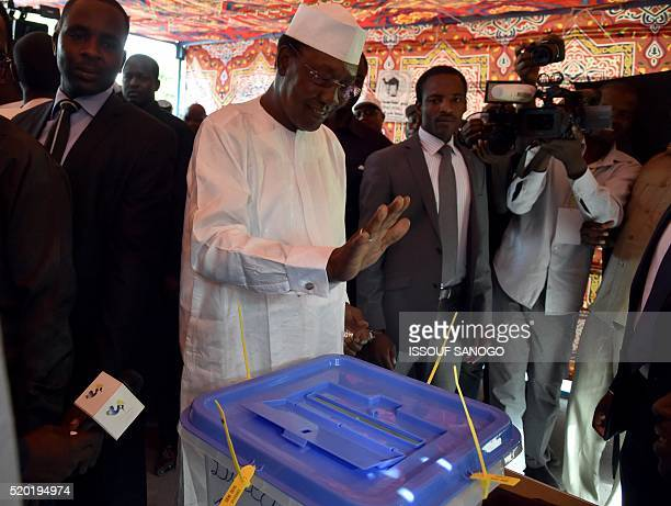Chad's incumbent president Idriss Deby Itno casts his ballot at the polling station in N'djamena for the presidential election on April 10 2016 A...