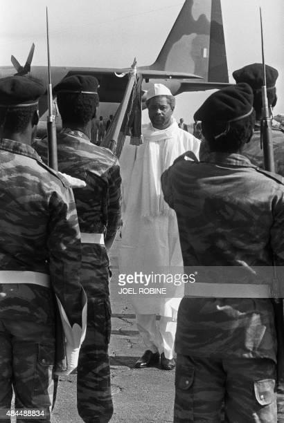 Chad's President Hissein Habré reviews the honour guard, upon his departure at N'Djamena airport, 04 December 1984. Le président tchadien Hissène...