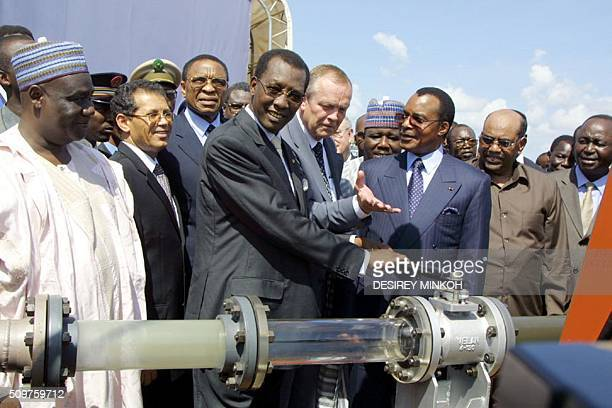 Chad's President Idriss Deby flanked by Esso Chad's director Ron Royal Congolese President Denis Sassou Nguesso Sudan's President Omar alBechir and...