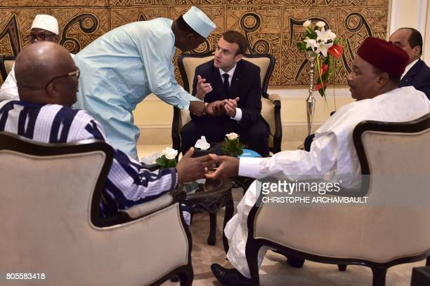 TOPSHOT Chad's president Idriss Deby Itno speaks with French President Emmanuel Macron as they gather with President of Burkina Faso Roch Marc...