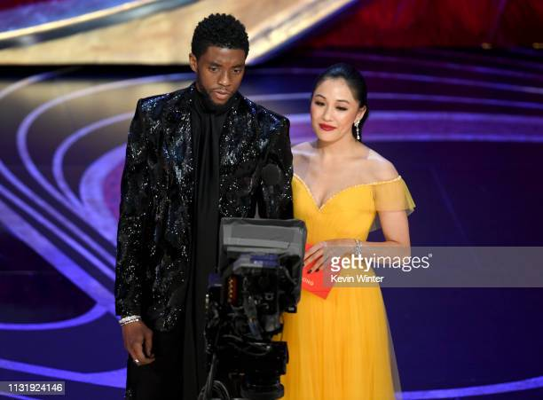 Chadwick Boseman and Constance Wu speak onstage during the 91st Annual Academy Awards at Dolby Theatre on February 24 2019 in Hollywood California