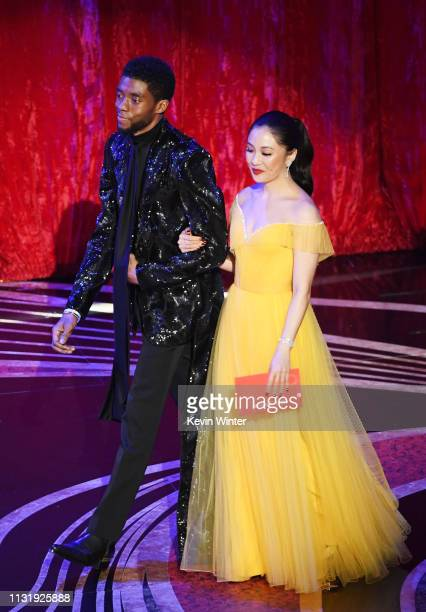 Chadwick Boseman and Constance Wu walk onstage during the 91st Annual Academy Awards at Dolby Theatre on February 24 2019 in Hollywood California