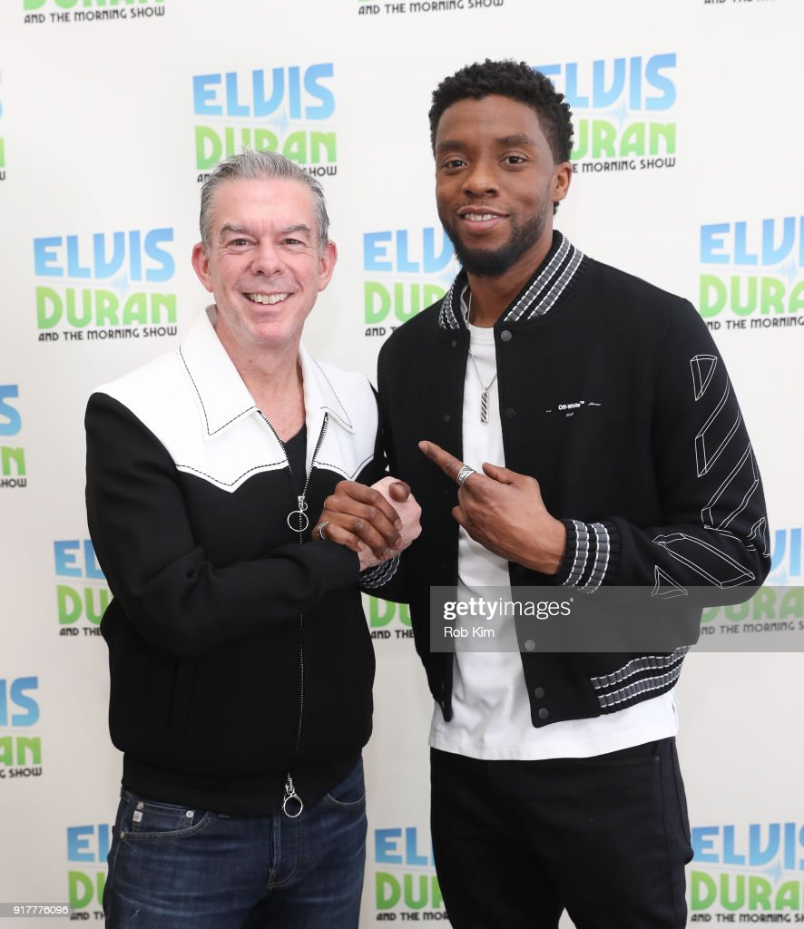 Chadwick Boseman (R) and Elvis Duran pose for a photo at 'The Elvis Duran Z100 Morning Show' at Z100 Studio on February 13, 2018 in New York City.
