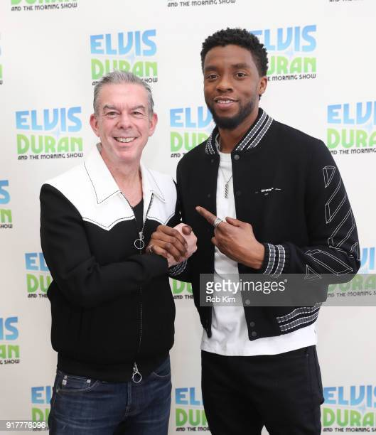 Chadwick Boseman and Elvis Duran pose for a photo at 'The Elvis Duran Z100 Morning Show' at Z100 Studio on February 13 2018 in New York City
