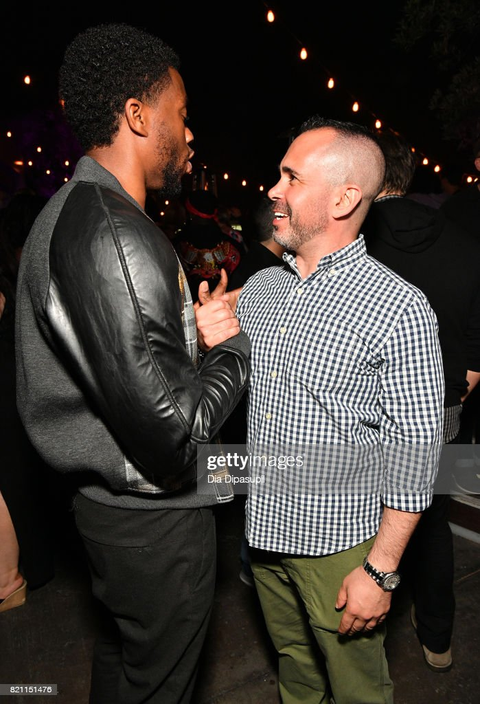 Chadwick Boseman (L) and Entertainment Weekly Editor-in-Chief Henry Goldblatt at Entertainment Weekly's annual Comic-Con party in celebration of Comic-Con 2017 at Float at Hard Rock Hotel San Diego on July 22, 2017 in San Diego, California.