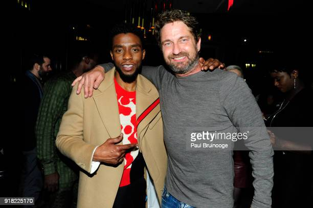Chadwick Boseman and Gerard Butler attend The Cinema Society with Ravage Wines Synchrony host the after party for Marvel Studios' 'Black Panther' at...