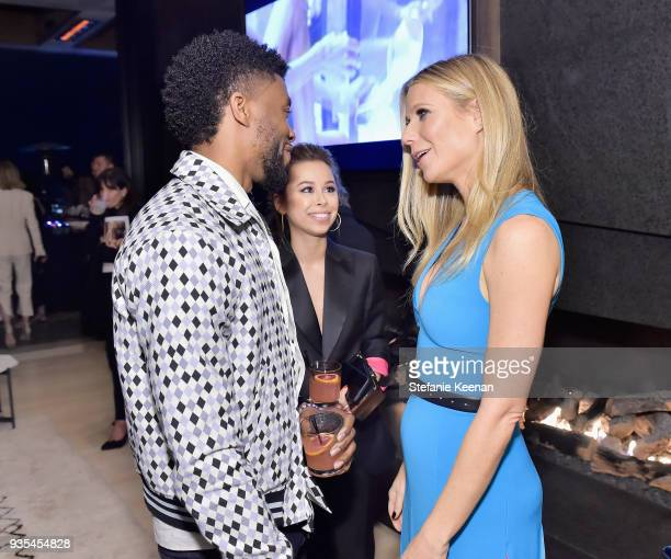 Chadwick Boseman and Gwyneth Paltrow attend The Hollywood Reporter and Jimmy Choo Power Stylists Dinner on March 20 2018 in Los Angeles California