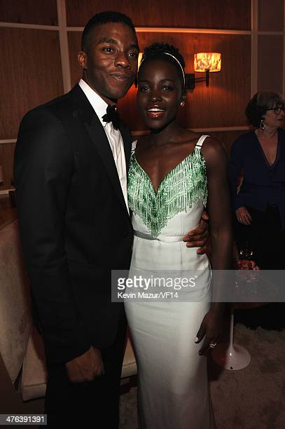 Chadwick Boseman and Lupita Nyong'o attend the 2014 Vanity Fair Oscar Party Hosted By Graydon Carter on March 2 2014 in West Hollywood California