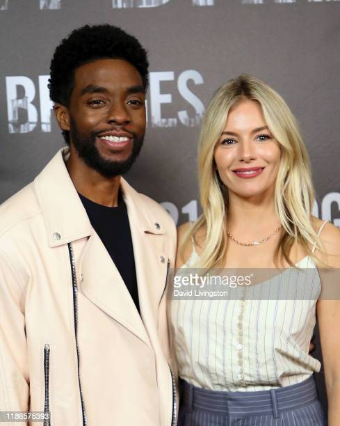 Chadwick Boseman and Sienna Miller attend a photocall for STX Entertainment's 21 Bridges at Four Seasons Hotel Los Angeles at Beverly Hills on...