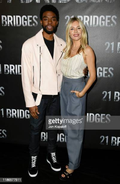 "Chadwick Boseman and Sienna Miller attend the photocall for STX Entertainment's ""21 Bridges"" at Four Seasons Hotel Los Angeles at Beverly Hills on..."