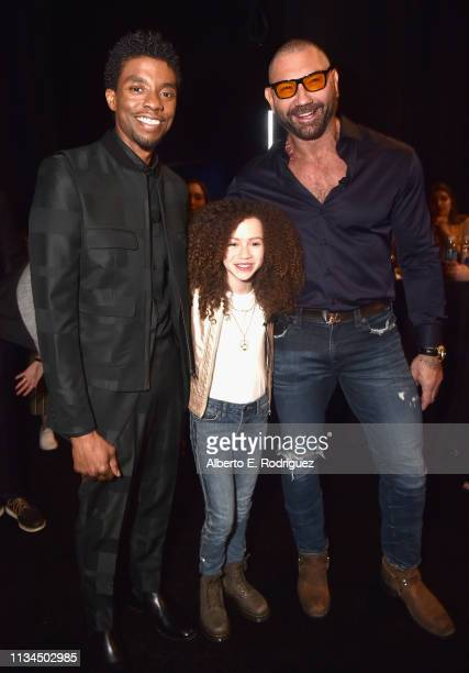Chadwick Boseman Chloe Coleman and Dave Bautista pose backstage at CinemaCon 2019 The State of the Industry and STXfilms Presentation at The...