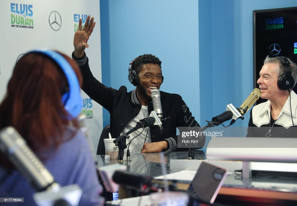 Chadwick Boseman talks with Elvis Duran during a visit to 'The Elvis Duran Z100 Morning Show' at Z100 Studio on February 13, 2018 in New York City.