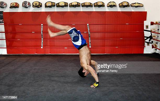 Chael Sonnen does a back flip before a workout at the Team Quest gym on June 26 2012 in Tualatin Oregon Sonnen will fight Anderson Silva July 7 2012...