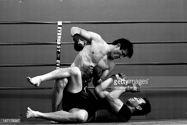 Chael Sonnen grapples with Yushin Okami during a workout at the Team Quest gym on June 26 2012 in Tualatin Oregon Sonnen will fight Anderson Silva...
