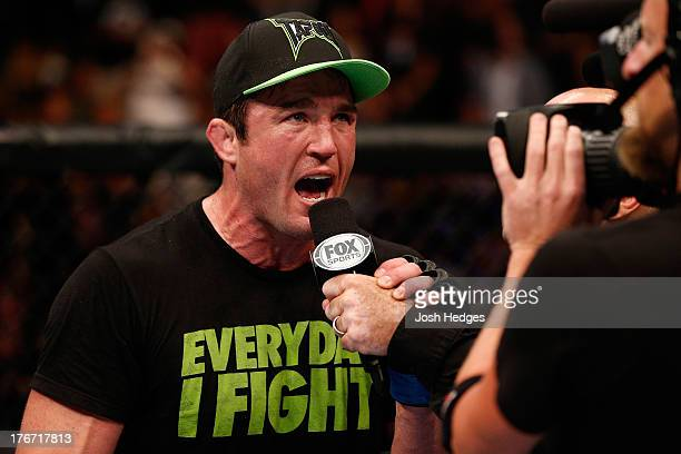 Chael Sonnen is interviewed by Joe Rogan after his submission victory over Mauricio Shogun Rua in their UFC light heavyweight bout at TD Garden on...
