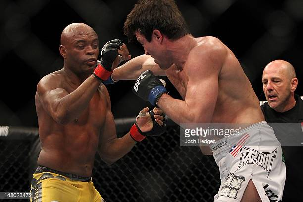 Chael Sonnen punches Anderson Silva during their UFC middleweight championship bout at UFC 148 inside MGM Grand Garden Arena on July 7 2012 in Las...