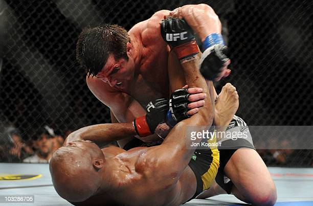 Chael Sonnen punches Anderson Silva while on the ground during the UFC Middleweight Championship bout at Oracle Arena on August 7 2010 in Oakland...