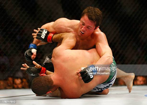 Chael Sonnen punches Mauricio Rua in their light heavyweight bout at TD Garden on August 17 2013 in Boston Massachusetts
