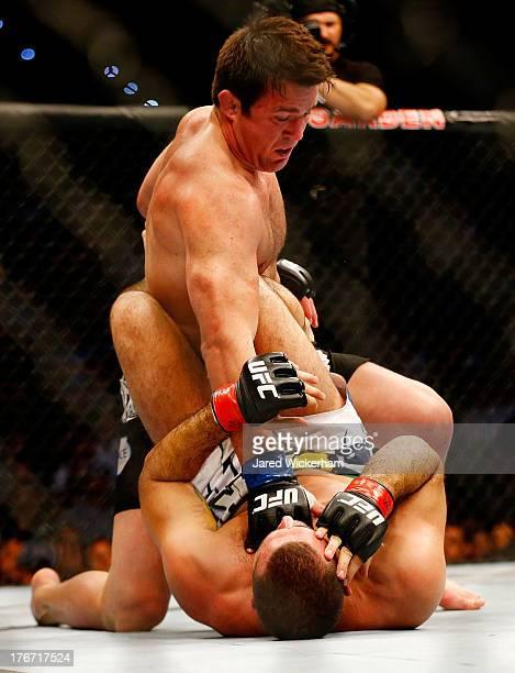 Chael Sonnen punches Mauricio Rua in their light heavyweight bout at TD Garden on August 17 2013 in Boston Massachusetts