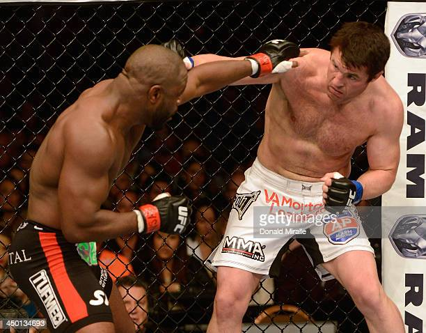 Chael Sonnen punches Rashad Evans in their light heavyweight bout during the UFC 167 event inside the MGM Grand Garden Arena on November 16 2013 in...
