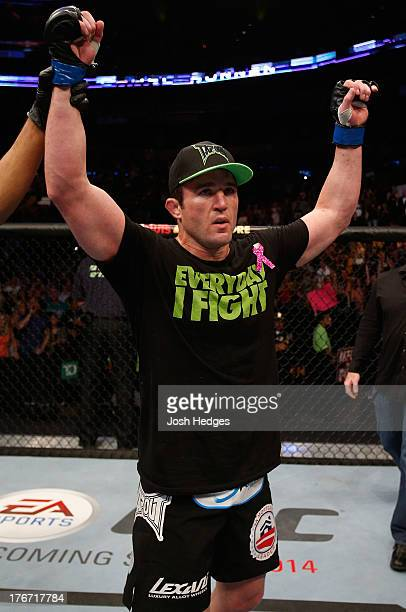 Chael Sonnen reacts after his submission victory over Mauricio Shogun Rua in their UFC light heavyweight bout at TD Garden on August 17 2013 in...