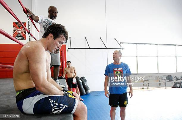 Chael Sonnen rests after a workout with his coaches Scott McQuary and Clayton Hires at the Team Quest gym on June 26 2012 in Tualatin Oregon Sonnen...