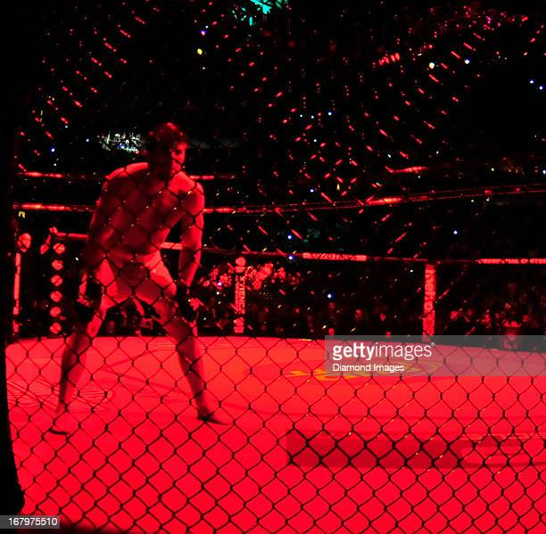 Chael Sonnen stands in the octagon waiting for Jon Jones to enter the cage before a lightheavyweight bout during UFC 159 Jones v Sonnen at Prudential...