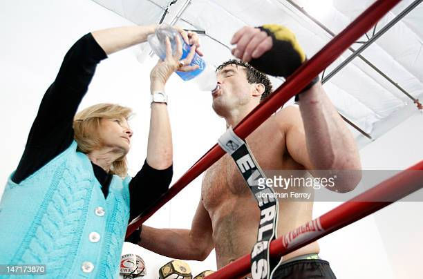 Chael Sonnen takes a water break with his mother Claudia during a workout at the Team Quest gym on June 26 2012 in Tualatin Oregon Sonnen will fight...