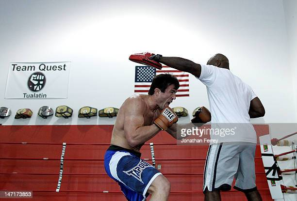 Chael Sonnen works out with is coach Clayton Hires at the Team Quest gym on June 26 2012 in Tualatin Oregon Sonnen will fight Anderson Silva July 7...