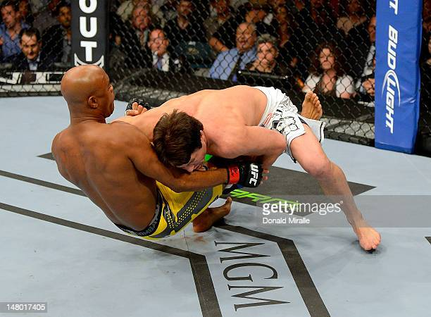 Chael Sonnen wrestles Anderson Silva during their UFC middleweight championship bout at UFC 148 inside MGM Grand Garden Arena on July 7 2012 in Las...