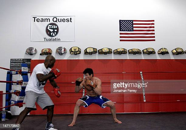 Chael Sonnenworks out with is coach Clayton Hires at the Team Quest gym on June 26 2012 in Tualatin Oregon Sonnen will fight Anderson Silva July 7...