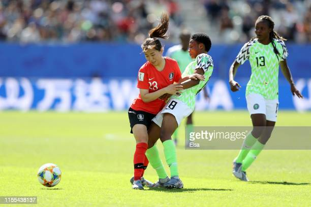 Chaerim Kang of Korea Republic collides with Halimatu Ayinde of Nigeria during the 2019 FIFA Women's World Cup France group A match between Nigeria...