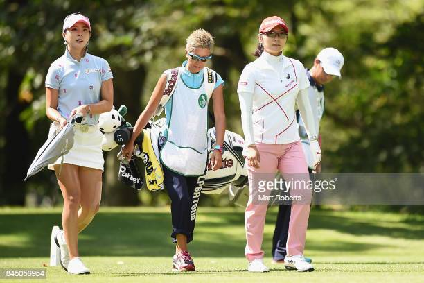 ChaeYoung Yoon of South Korea and Saiki Fujita of Japan walk the 12th hole fairway during the third round of the 50th LPGA Championship Konica...