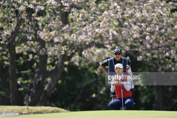 ChaeYoung Yoon of South Korea lines up her putt on the 14th hole during the first round of the CyberAgent Ladies Golf Tournament at the Grand Fields...