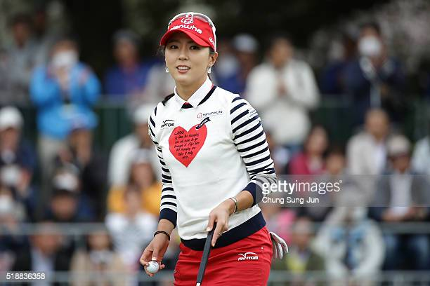 ChaeYoung Yoon of South Korea reacts after a putt on the 18th hole during the final round of the YAMAHA Ladies Open Katsuragi at the Katsuragi Golf...