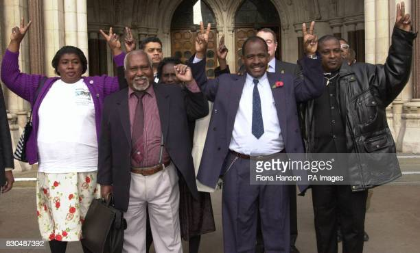 Chagos islander Louis Bancoult celebrates with islanders as he leaves the High Court London following his victorious legal battle with the British...