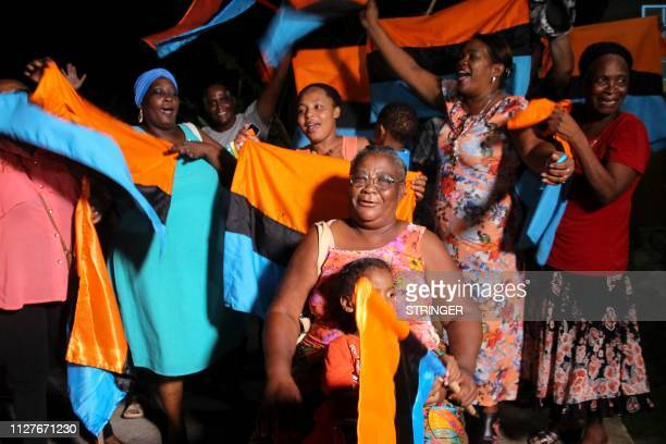 Chagossian families celebrate at the Groupe Refugies Chagos headquarters on February 25 2019 the news that the United Nations' top court had told...