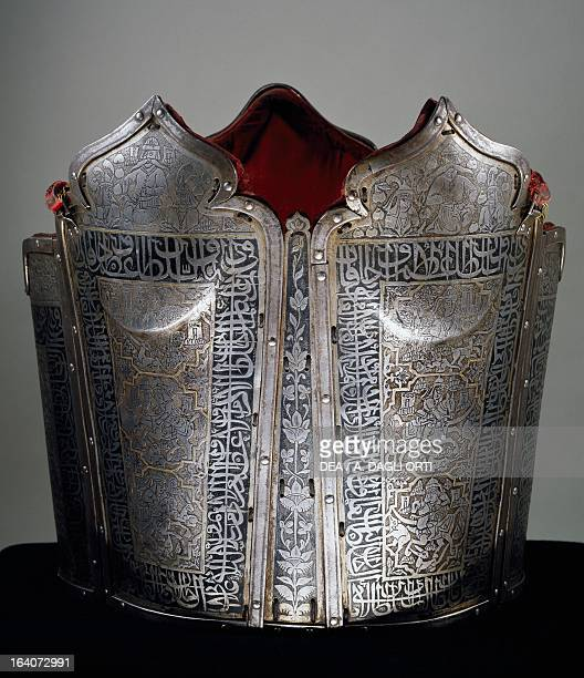 Chahara ineh in steel and gold with inscriptions IndoPersian manufacturing 18th century Florence Museo Stibbert