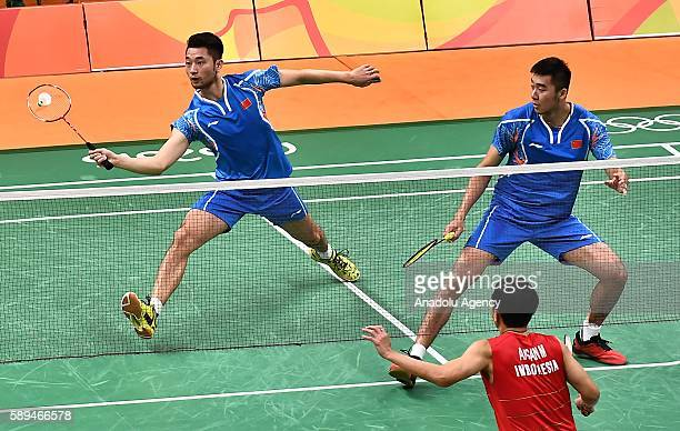 Chai Biao and Hong Wei of China compete against Ahsan Mohammad and Setiawan Hendra of Indonesia during the Mens Doubles Badminton match on Day 8 of...
