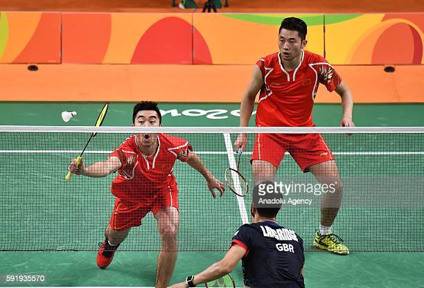 Chai Biao and Hong Wei of China compete against Ellis Marcus and Langridge Chris of Britain in the Mens Doubles Bronze Medal Match on Day 13 of the...