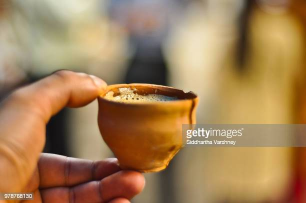 chai, in a kulhad, anyone? - chai stock photos and pictures