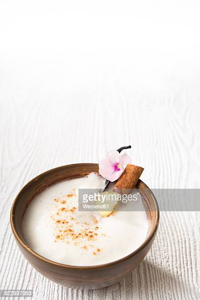 Chai Latte Iced tea in a tea bowl with cinnamon stick and vanilla pod
