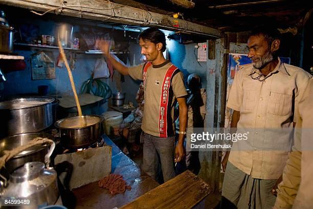 A chai Wallah makes a chai brew in the Jari Mari slum next to Mumbai Airport on February 3 2009 in Mumbai India The redevelopment of the Jari Mari...