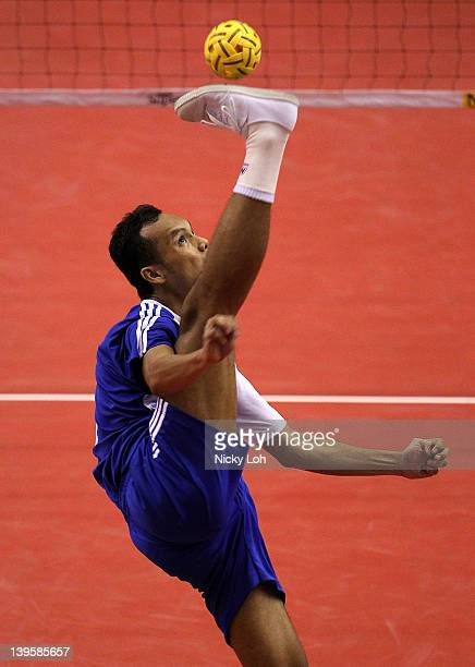 PALEMBANG SUMATRA INDONESIA FEBRUARY 23 Chaichana Anuwat of Thailand serves to the US during day one of the ISTAF Super Series at Palembang Sport...