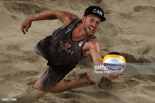 Chaim Schalk of Canada dives for the ball during a Men's Round of 16 match between Canada and Netherlands on Day 8 of the Rio 2016 Olympic Games at...