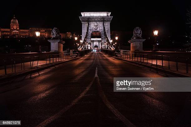 Chain Bridge Against Sky In City At Night