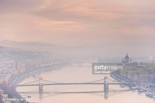 Chain Bridge and Parliament Building besides River Danube at dawn, Aerial View