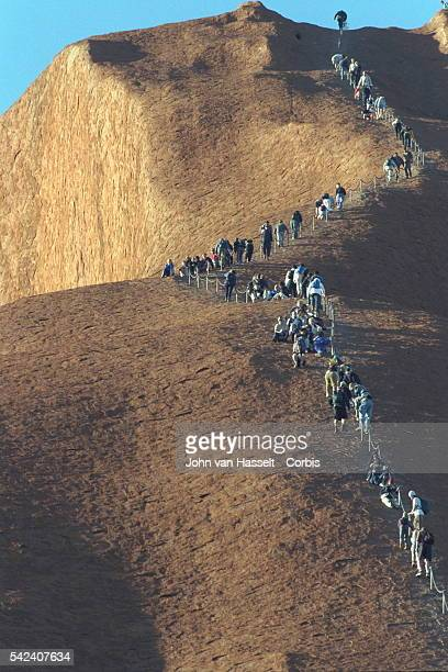 A chain has been built to make the climb easier for the thousands of people who come from all overthe world to scale the heights of the Uluru mono...