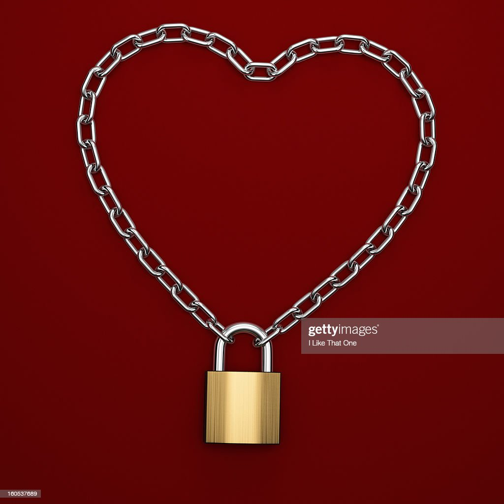 Chain in the shape of a heart with a padlock : Stock Photo